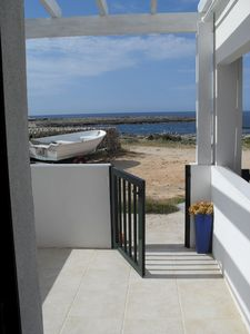 Photo for Enchanting fisherman's cottage in front of the sea in Biniancolla