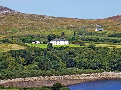 Photo for End terrace of former Coastguard Cottages built in 1876 in exceptional location beneath Knocka…
