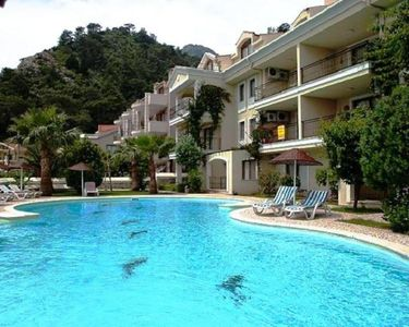 Front of Apartment with Large pool.Out of the veranda to the garden by the pool
