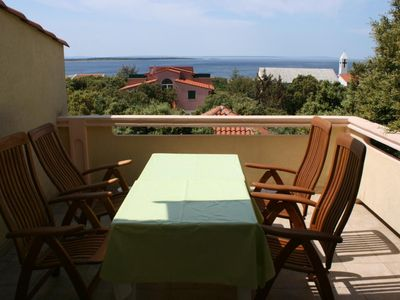 Photo for Two bedroom apartment with terrace and sea view Mandre, Pag (A-6309-b)