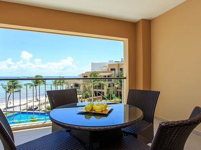 Photo for NEW LISTING! Upscale condo in beachfront resort with shared infinity pool, gym