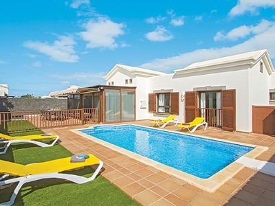 Photo for Spacious family villa w/ gated pool, short drive to the resort centre
