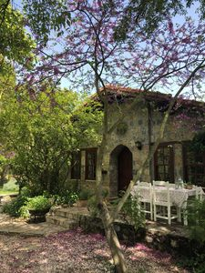 Photo for Traditional stone cottage with stunning garden in historic Kaya village.