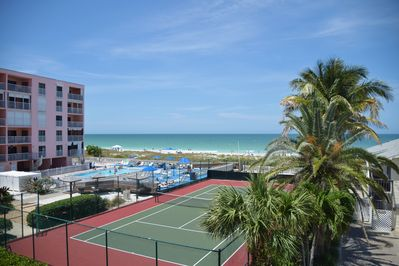 Stunning view of the Gulf of Mexico, pool and tennis court from your balcony!