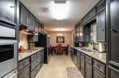 Brand new kitchen with granite counters, brand new appliances, and a Keurig.