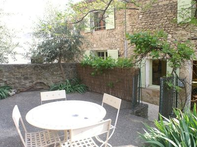 Photo for Charming comfortable cottage+garden& terraces in the heart of a medieval village