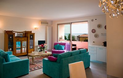 Photo for Beautiful Penthouse in the center, facing the lake, near the beach, free wifi