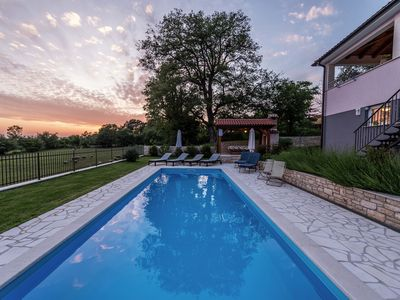 Photo for New modern luxury house, situated on a private plot with large garden and pool