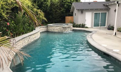 Photo for 4 bedroom, 3 bathrooms Pool Home