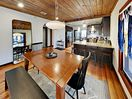 Dining Area - Dine together at the large wooden table with bench seating for 8.