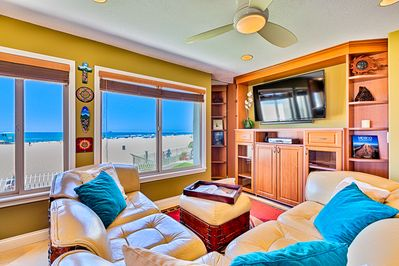Living room with ocean, beach and strand view.  Smart TV with cable and Wi-Fi