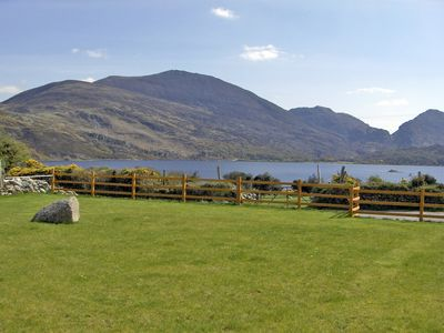 The view from the property of Lough Guitane with the Kerry mountains in the background
