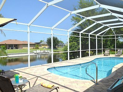 Photo for Holiday oasis with 4 bedrooms, heated pool, fresh water canal