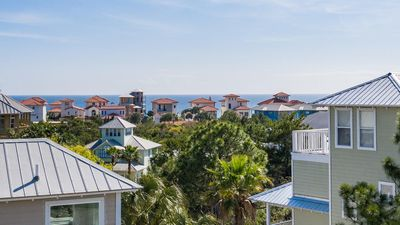 Photo for Gulf Views, 5 minute walk to the beach. Charming, 4 bedrooms 4 baths, comm pool
