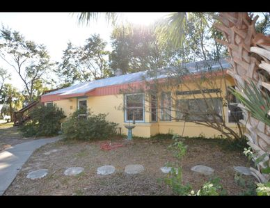 Photo for Charming beach cottage! Just one block to the beach! Pet friendly!