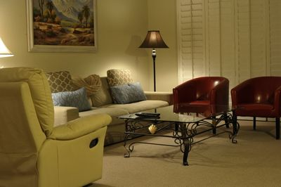 The living room provides the perfect quiet place to read and relax or watch TV.