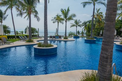 Imagine yourself in this gorgeous pool steps from our resort's private beach!