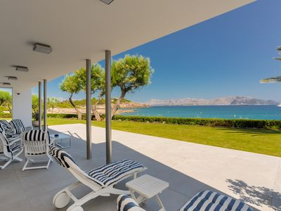 Photo for Direct & private access to the beach.180º panoramic views to bay from all rooms.