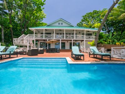 Photo for Ultimate Beachfront home w/ Boat, Pool, Paddleboards, Private Dock, & more