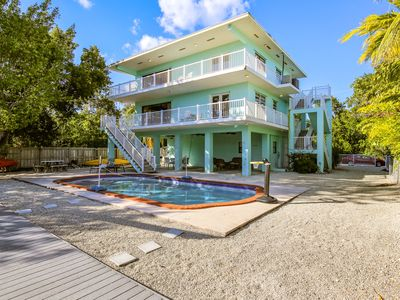 Photo for NEW LISTING! Canal front home with open floor plan and  a pool!