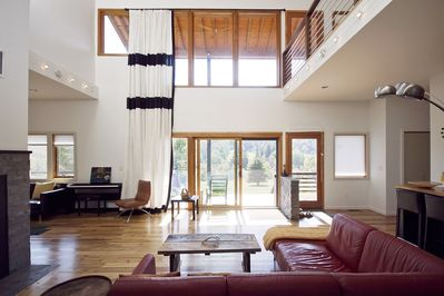 Windows run the entire height of the room taking advantage of the view.