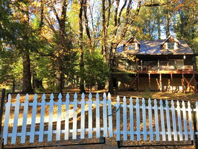 Front of cabin. Surrounded by tall mature oak trees