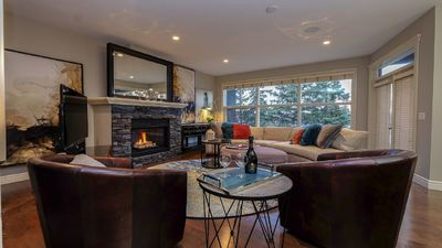 Great room at dusk with towering evergreens with roof top vistas on walk-out lot