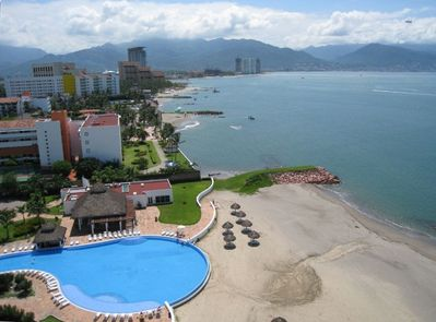 View from your balcony of the pool, beach and town of Puerto Vallarta