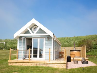 Photo for A deluxe beach hut that sleeps 4 guests  in 0 bedrooms