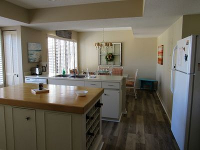 Photo for Updated Decor, Roomy Open Kitchen & Dining, Close to Pool/Golf Cart Included
