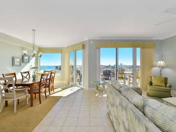 Decorator furnished side view unit in a deluxe oceanfront building with a large indoor pool, outdoor pool, exercise room, large sundeck and more