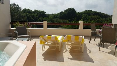 Photo for Private Penthouse with jacuzzi and pool, free parking, steps from 5th Av & beach