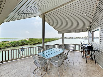 Photo for Waterfront Home w/ Large Covered Deck & 2 Pools - Direct Access to Channel!