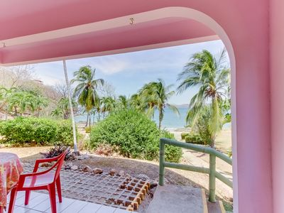 Photo for Beachfront condo w/ shaded patio & ocean view - steps to sand, walk to town!