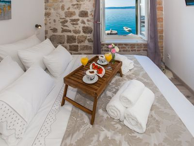 Photo for Seafront apartment in historical Cippico castle