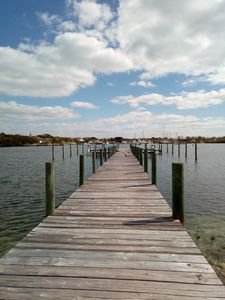 Island Reach includes a slip at a private shared dock a minute away by golf cart