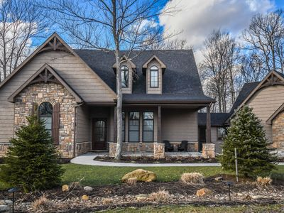 Photo for Charming golf & ski area home with a hot tub & outdoor fireplace!