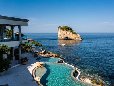 Photo for Beachfront Estate with sunset views over the famous Los Arcos of Puerto Vallarta