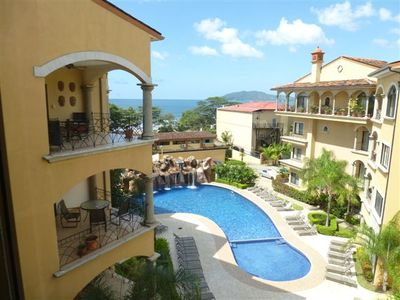 Photo for Family vacation: Ready, Set, Go! - big pool and steps from the beach.