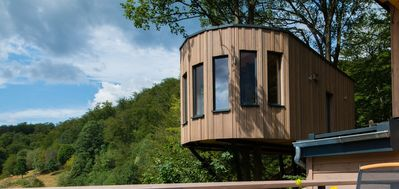 Photo for Romantic tree house with rain / waterfall shower & mountain view