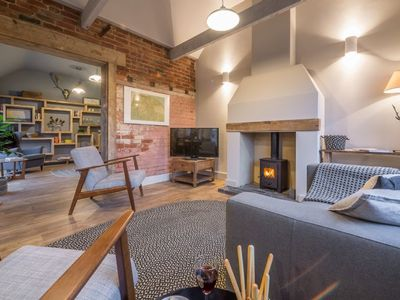 Photo for This luxury detached open-plan barn conversion is effortlessly relaxed.