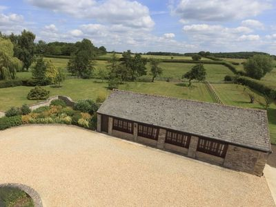 Photo for The Cotswold Manor Cottage, Exclusive Hot Tub, Games Barn, 70 acres of Parkland