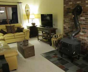 Photo for Cozy Mountain Condo- Close to Skiing- Wood stove, WiFi, Cable, Pool, Hot tub