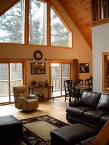 windows that look out over the mountain, open floor plan, deer visit daily