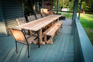 covered deck with custom cedar table to seat your whole family!