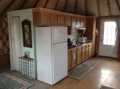 View of kitchen and front door. Closet on left.