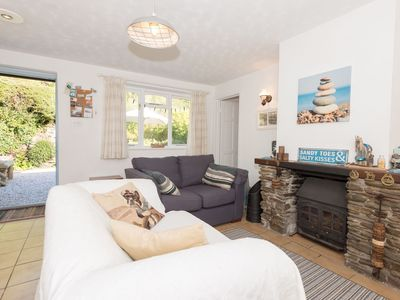 Photo for Pretty cottage just a stones throw from the beach.