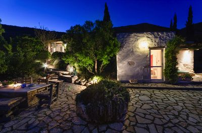 The patio near the lower cottage by night.