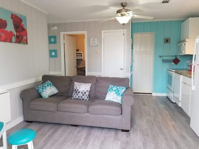 New Flooring, freshly painted walls and pillows