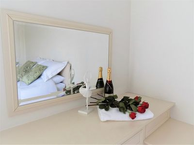 Show your loved ones you care. Flowers and champagne on arrival.